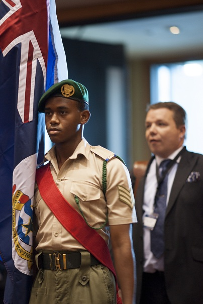 Mr. Alastair Swarbrick, Auditor General of the Cayman Islands enters proudly during the procession.